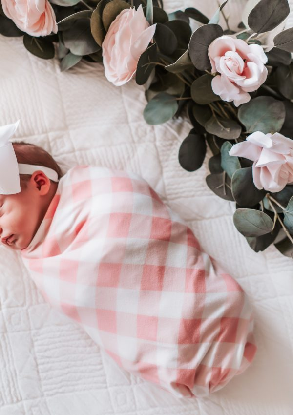 newborn baby, gingham swaddle, newborn photoshoot, greenery and baby